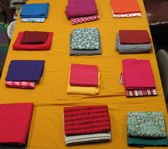 Auditioning fabrics for the fan quilt